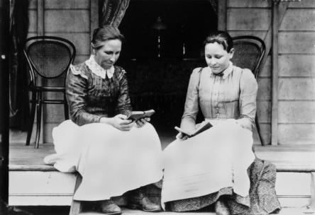 statelibqld_1_132733_two_women_reading_on_a_verandah_at_ingham_ca-_1894-1903
